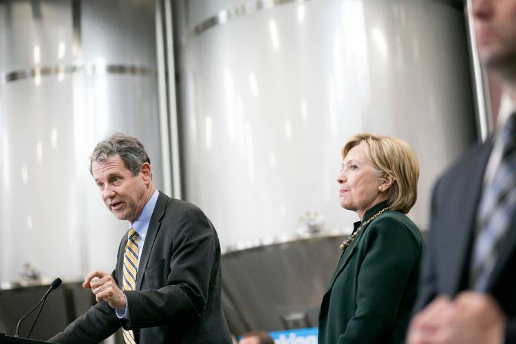 Sherrod Brown introduces Hillary Clinton during a stop at Jackie O's brewery in Athens, Ohio, last year. (Maddie McGarvey for The Washington Post)