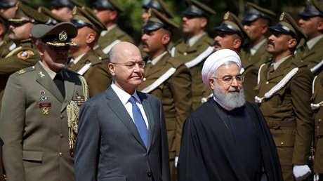El presidente iraní, Hasán Rohaní, junto con su homólogo iraquí, Barham Salih, durante su visita a Irak. 11 de marzo de 2019.