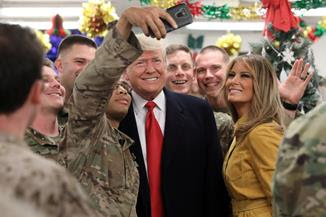 Trump surprises troops with trip to Iraq.