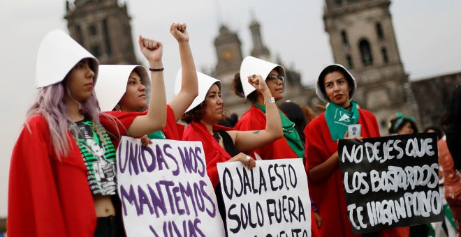 Women participate in a march during International Women's Day in Mexico City