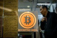 A shop in Hong Kong that accepts the digital currency Bitcoin. Bitfinex, a Bitcoin exchange based in the city, said that any outstanding settlements would be made at the price before it reported the hacking.