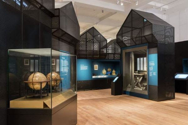 View of the Science City gallery showing tall display cabinets with various objects in