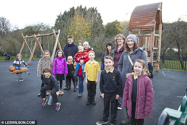 Parents and children at The Orchard after its revamp. A             local organisation, Bath Recreation Ltd, stepped in to offer             support and community efforts helped raise £2,500 towards             the new playground, which opened in the summer