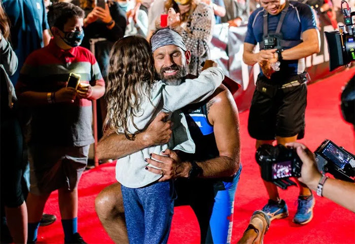 Jay Hewitt hugging his daughter