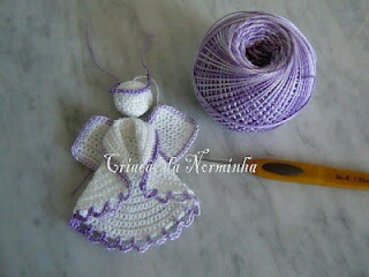 Folded circle on crocheted angel