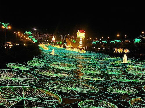 The city of Medellin in Colombia, South America, lights up every year for Christmas. The picture shows the Medellin River is set aglow!