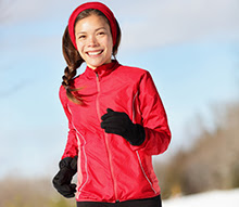 Smiling woman running outside.