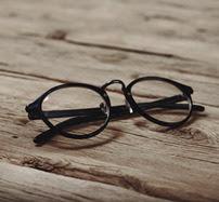 glasses on wooden floor