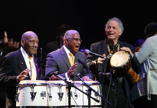 David Amram, as a featured guest with Bobby Sanabria's orchestra, playing with Candido (left) and Felipe Luciano at the Apollo Theater in 2011 for a tribute to the legacy of Mario Bauza, the master of Afro-Cuban jazz.