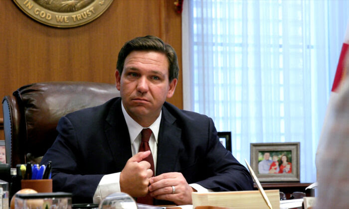 Floridа Gov. Ron DeSantis listens to a report from a member of his administration during a meeting at the governor's office in Tallahassee, Fla., on April 1, 2021. (Screenshot via The Epoch Times)