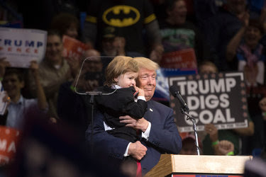 Donald J. Trump with a boy from the audience on Monday in Wilkes-Barre, Pa. In recent days, dozens of Republican elected officials have rejected Mr. Trump.