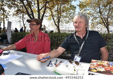 Marseille, France - October 06, 2016 : French cartoonists Patrick Redon Red and Philippe Umbdenstock Phil at the 5th edition of the International festival of press and political cartoons at l'Estaque.
