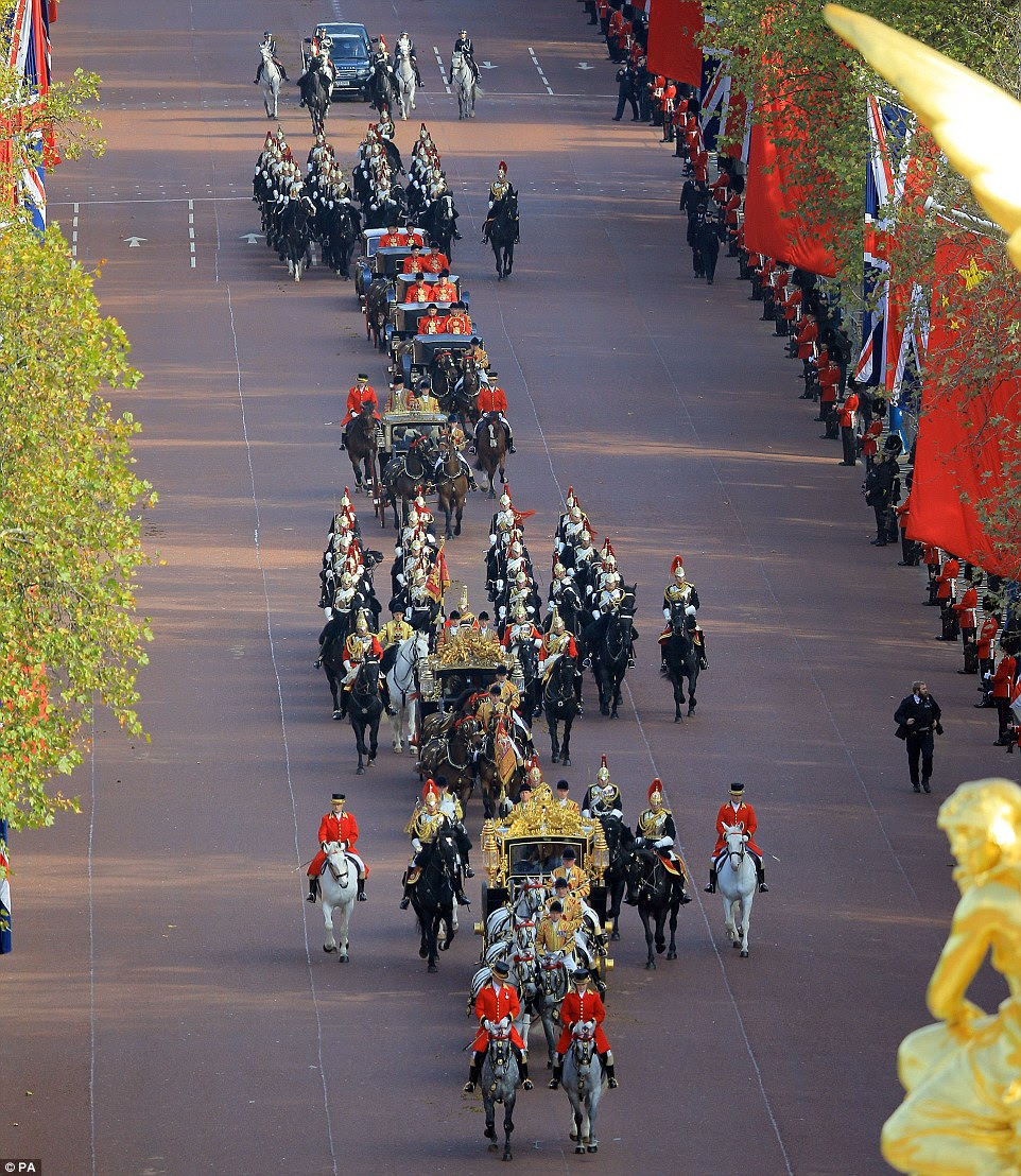 After being greeted at the Horse Guards Parade, Mr Xi and his wife joined the Queen and Prince Philip for the procession to the palace