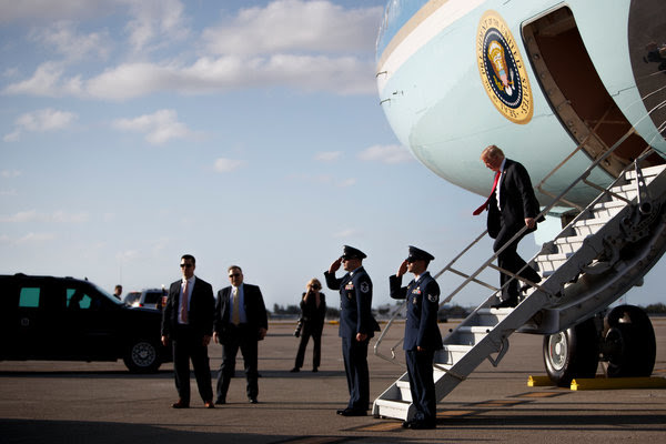 """President Trump arriving in Florida last week. He told reporters in the Oval Office after a call with the Russian leader that he expected to """"be seeing President Putin in the not-too-distant future."""""""
