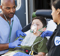 EMTs with child and ambulance