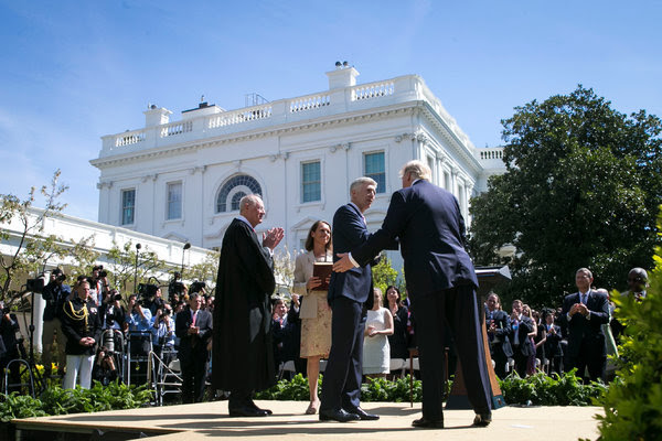 Justice Neil M. Gorsuch at the White House last week with President Trump, Justice Anthony Kennedy, and his wife, Marie Louise Gorsuch. He will hear his first arguments from the Supreme Court bench this week.