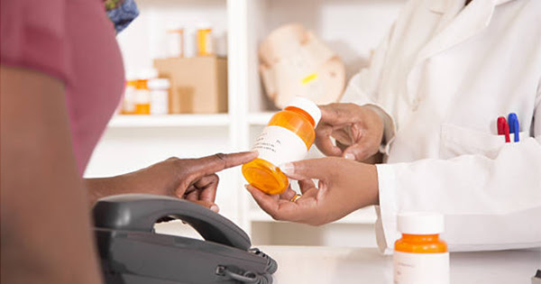 African American buying medicine, medications