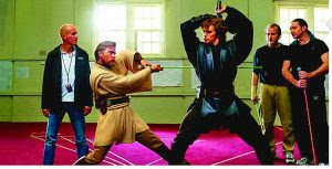 Kyle-Rowling-overlooking-the-fight-choreography-on-the-Star-Wars-set
