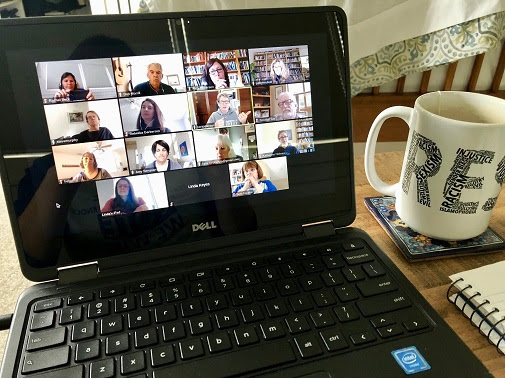 Laptop showing a Zoom meeting with volunteers contacting voters
