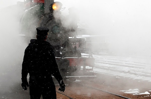 Image: Steam and snow surround Mike Grimm waits for the engine of a vintage 1880 train to back into position in Hill City, S.D., Thursday morning, Sept. 11, 2014. Riders on the popular summertime tourist attraction got a very wintertime view as a storm brought as much as 8 inches of snow to parts of the Black Hills. Snowfall in downtown Rapid City marked the earliest such event since 1888; that was before South Dakota was even a state.