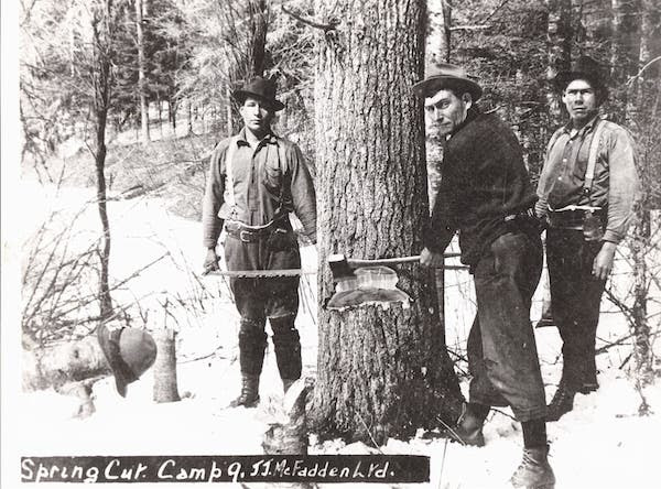 vintage lumberjacks using ax to chop tree