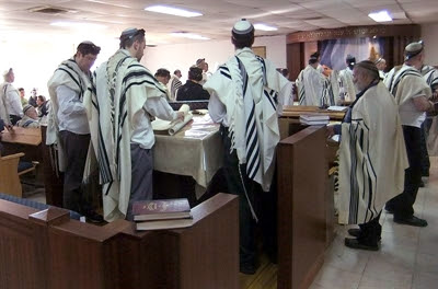 Morning                 prayer at an Israeli synagogue