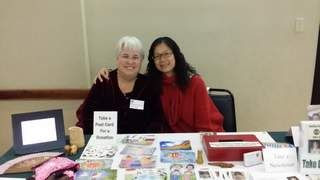 Xiaomin Mai Oney and Betty Cutts at the International Dinner at Morehead State University.