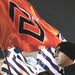 Members of the far-right party Golden Dawn carried party flags and Greek flags at a rally in Athens on Saturday night.