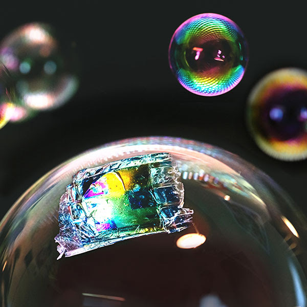 Fully printed, ultrathin solar cell is light and flexible enough to rest on the surface of a soap bubble.