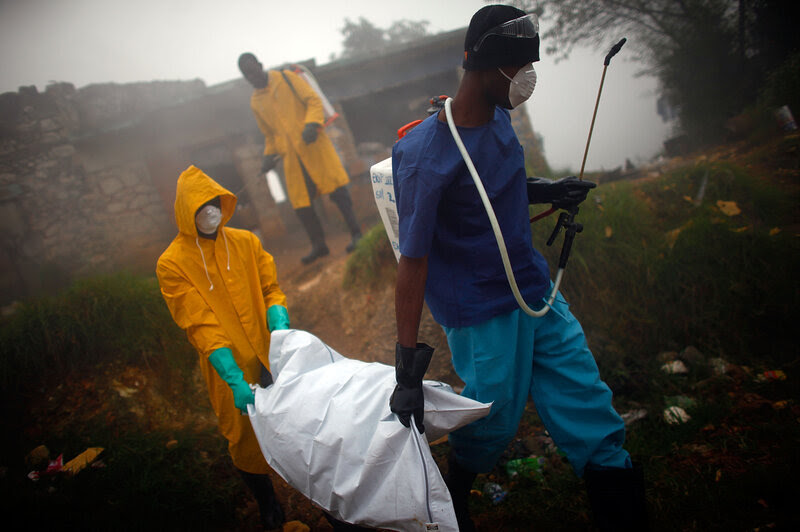 Health workers collect the body of a cholera victim in Petionville, Haiti, February 2011. The disease first appeared on the island in October 2010, likely introduced by U.N. peacekeepers from Nepal, possibly a single individual.