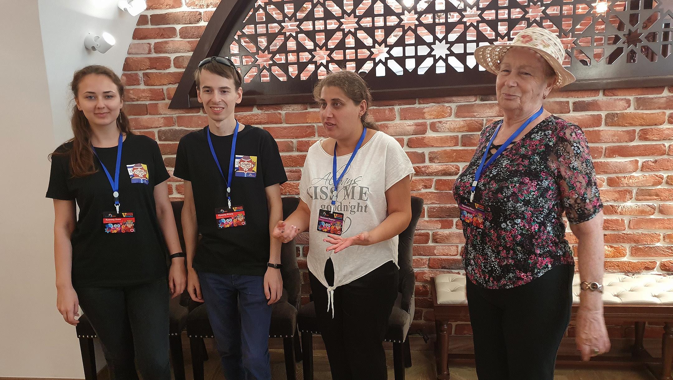 Musia Efimova, right, Marina Edakova and Fiodor and Anna Kushnir at the Wooden Synagogue of Chisinau, Moldova on Aug. 26, 2019. (Cnaan Liphshiz)