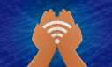 Cupped hands hold a precious wi-fi symbol