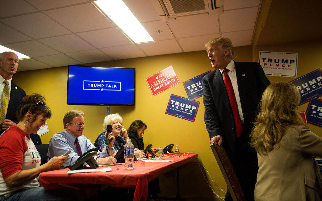 Donald J. Trump on Monday with volunteers at a call center backstage before a campaign event in Asheville, N.C.