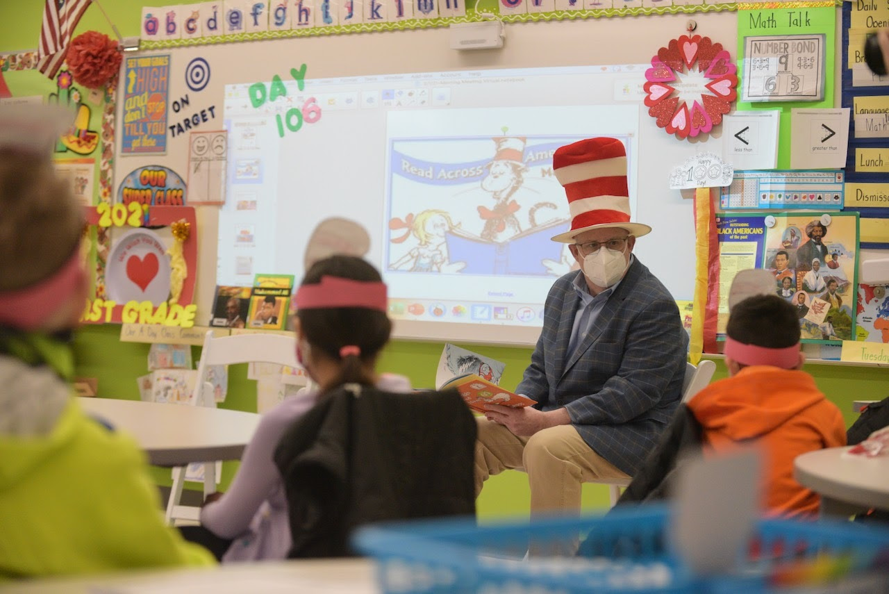 gov. hogan reads to elementary students while wearing a