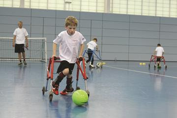 A boy playing framed football indoors