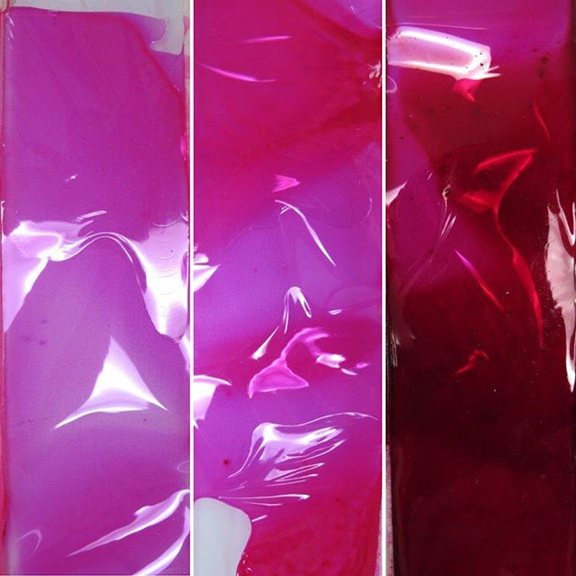 Films of Rhodamine B in nitrocellulose lacquer. From left to right: 2%, 8% and 80% concentration of dye.