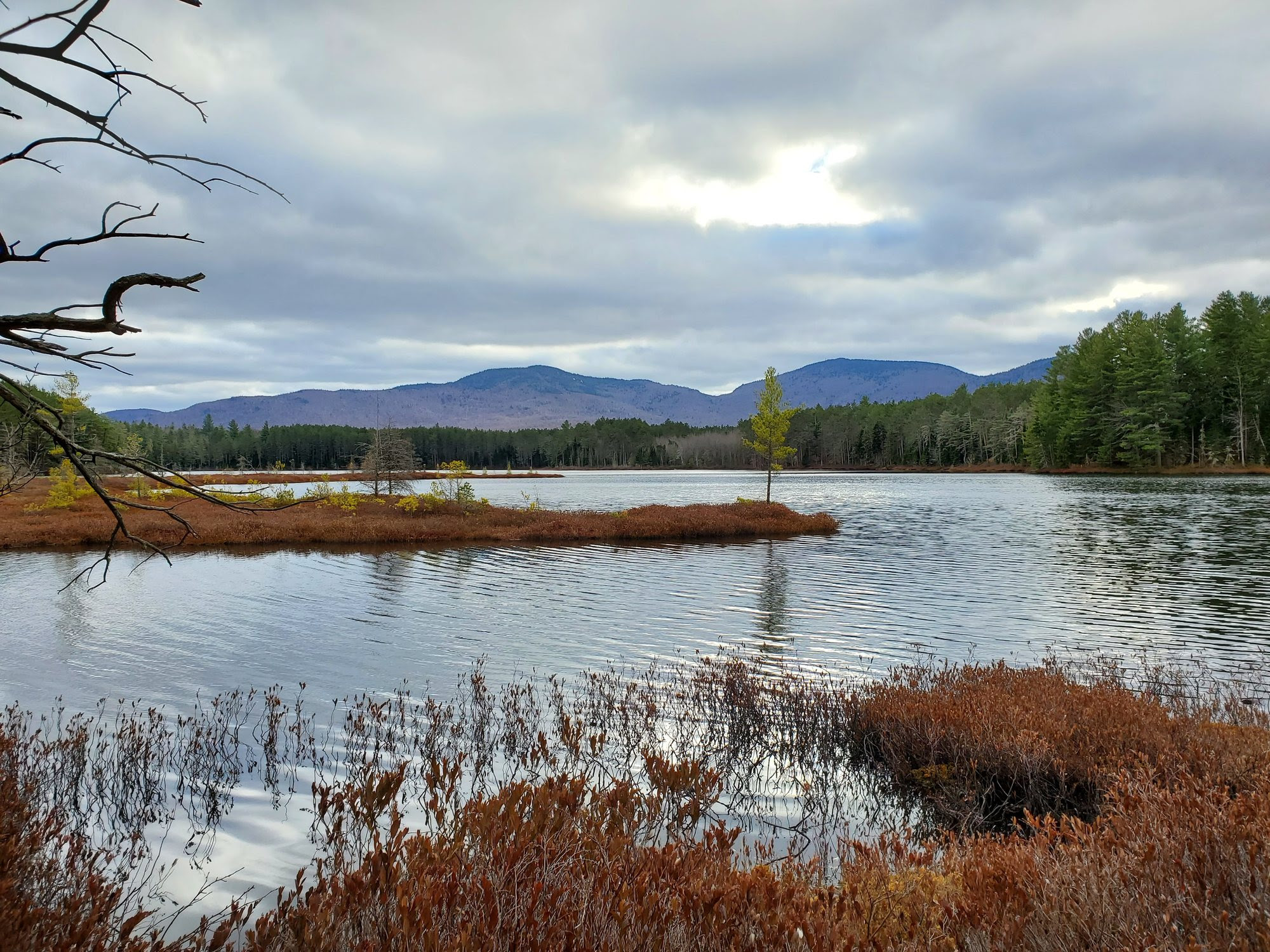 Adirondack pond with mountains in background