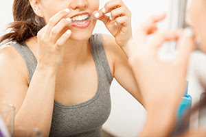 Woman using whitening strips
