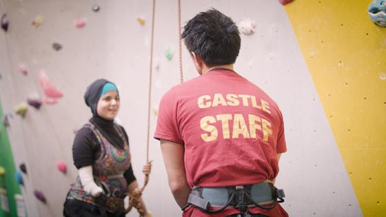 A woman with her climbing instructor