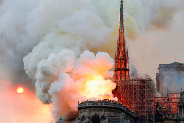 Slide 21 of 31: TOPSHOT - Smoke and flames rise during a fire at the landmark Notre-Dame Cathedral in central Paris on April 15, 2019, potentially involving renovation works being carried out at the site, the fire service said. - A major fire broke out at the landmark Notre-Dame Cathedral in central Paris sending flames and huge clouds of grey smoke billowing into the sky, the fire service said. The flames and smoke plumed from the spire and roof of the gothic cathedral, visited by millions of people a year, where renovations are currently underway. (Photo by FRANCOIS GUILLOT / AFP)        (Photo credit should read FRANCOIS GUILLOT/AFP/Getty Images)