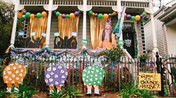 """Across New Orleans, thousands of homes like this one — the """"Queen of Bounce House"""" — are decorated for Mardi Gras. People drive from house-to-house because the city canceled parades due to COVID."""