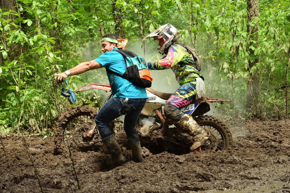 Saturday's overall ATV winner, Johnny Gallagher, lends a helping hand to Mckenzie Tricker.