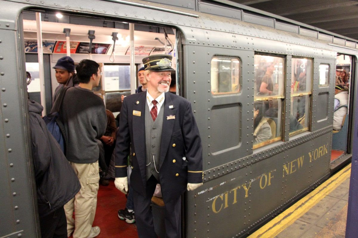 Conductor in costume with vintage 1930s train car