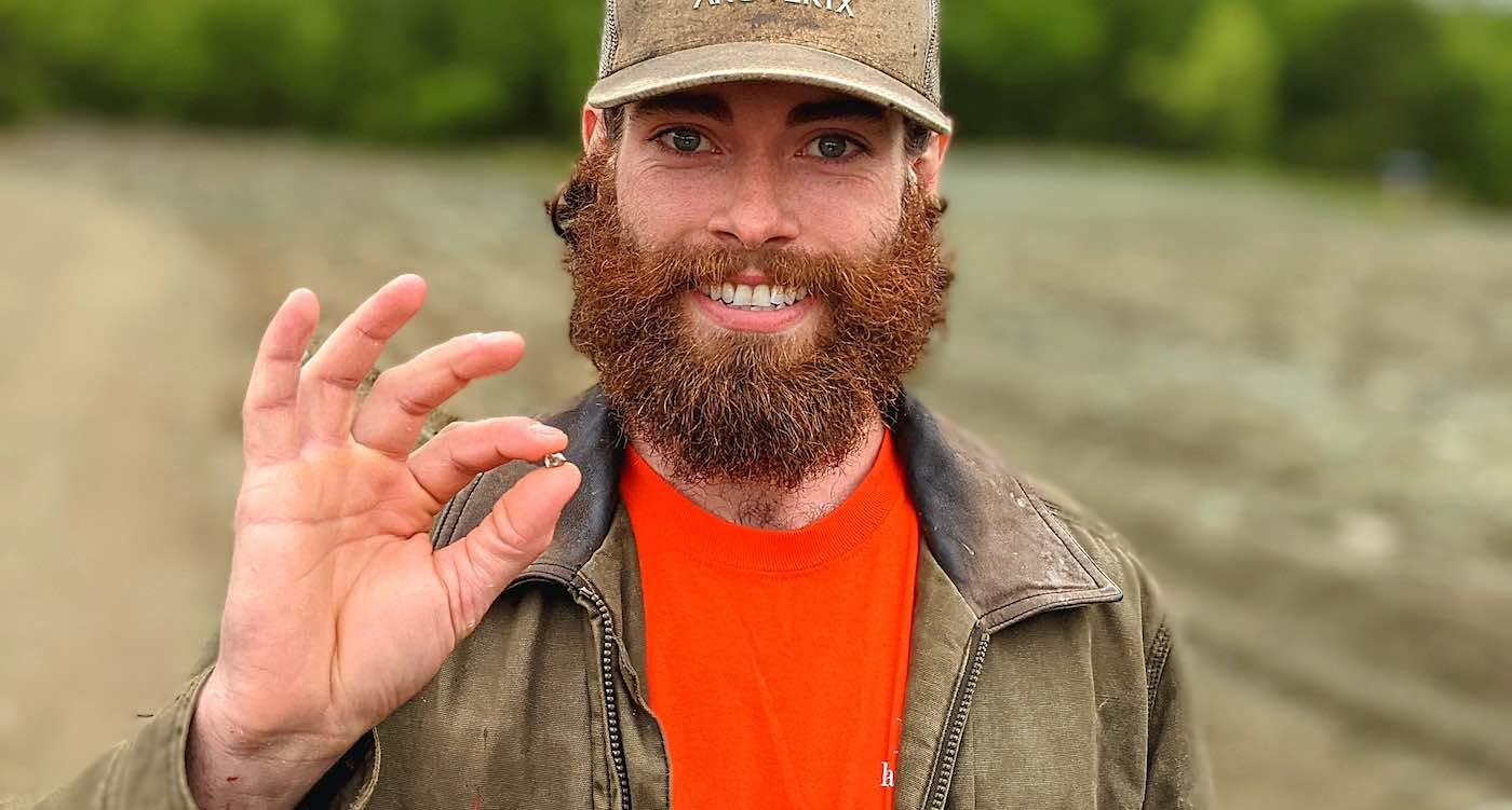 Man holding diamond he found in Crater of Diamonds State Park